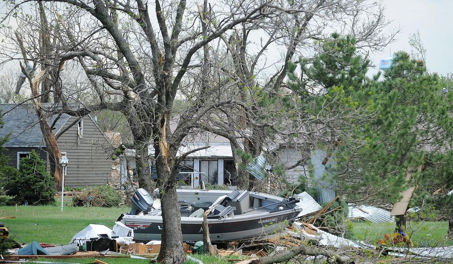 Tornado damage is shown on Sunday, May 10, 2015, in Delmont, S.D., after a tornado hit the town earlier in the day.  The tornado hit the town southwest of Sioux Falls on Sunday morning, injuring nine people and damaging at least 20 buildings, including a century-old church. Two people remain hospitalized. Crews are working to restore water, electricity and phone service. (Joe Ahlquist/The Argus Leader via AP) NO SALES