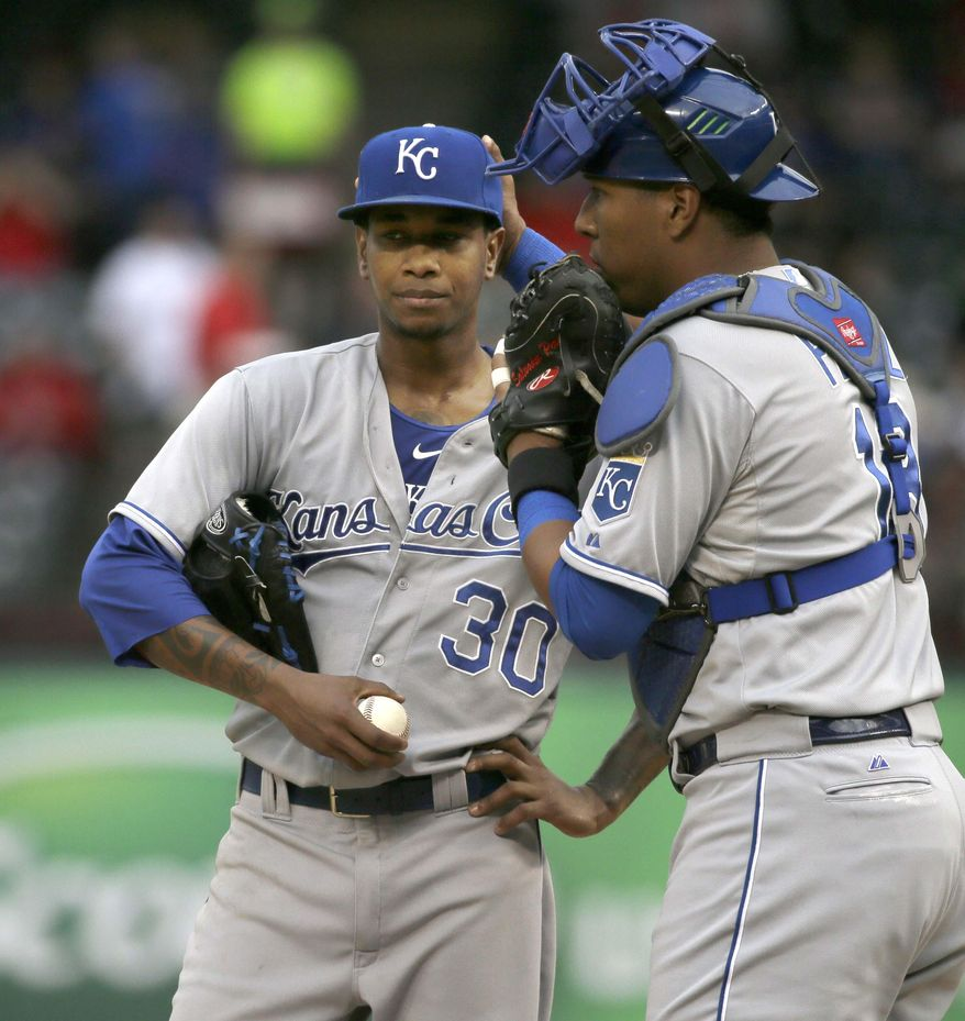 Kansas City Royals catcher Salvador Perez, right, tries to calm down starting pitcher Yordano Ventura (30) during the first inning of a baseball game against the Texas Rangers in Arlington, Texas, Wednesday, May 13, 2015. (AP Photo/LM Otero)