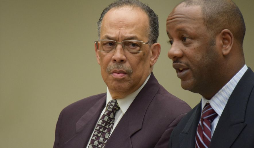 Clarence Heath, left, stands with defense attorney Doug Hampton during his sentencing in District Court, Wednesday, May 13, 2015, in  Southfield, Mich. Heath was sentenced to 10 days in jail for a fiery crash that killed a pregnant Detroit-area woman who was driving a Jeep Liberty under recall by Fiat Chrysler. (Aftab Borka/The Oakland Press via AP) )