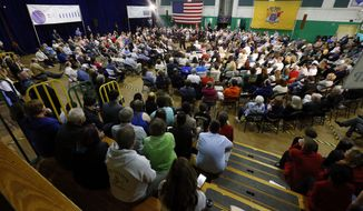A crowd listened to New Jersey Gov. Chris Christie has been holding frequent town halls in the early-voting state of New Hampshire including the Voters First Forum. (AP Photo/Julio Cortez)