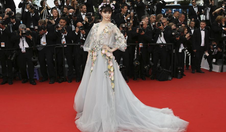 Actress Fan Bing Bing poses for photographers as she arrives for the screening of the film Mad Max: Fury Road at the 68th international film festival, Cannes, southern France, Thursday, May 14, 2015. (Photo by Joel Ryan/Invision/AP)