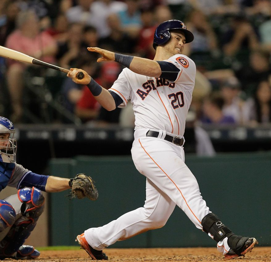 Houston Astros'  Preston Tucker (20) doubles down the right field line against the Toronto Blue Jays in the fifth inning of a baseball game Thursday, May 14, 2015, in Houston. (AP Photo/Bob Levey)