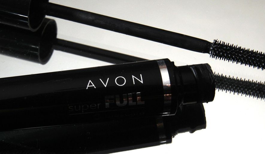 FILE - This July 28, 2010 file photo shows a container and brush of Super Full mascara by Avon in North Andover, Mass. Shares of Avon were halted three times in volatile trading Thursday, May 14, 2015, after a regulatory filing announcing an $8 billion takeover bid for company came under scrutiny. (AP Photo/Elise Amendola, File)