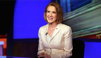 Carly Fiorina is among a crowd of Republican presidential hopefuls racing back to Iowa to appear at multiple events this weekend. (Associated press)