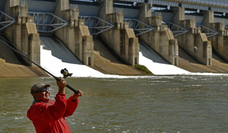 """FILE - In this April 29, 2015, file photo, Antonio Pinon casts into the spillway of Lavon Lake to catch fish after the Army Corps of Engineers opened up three doors in the dam in Lavon, Texas. Recent heavy rains have helped Texas emerge from the worst of the years-long drought. The U.S. Drought Monitor on Thursday, May 14, 2015, indicated Texas, for the first time since mid-2012, is no longer in the """"exceptional drought"""" category. (Nathan Hunsinger/The Dallas Morning News via AP) MANDATORY CREDIT; MAGS OUT; TV OUT; INTERNET USE BY AP MEMBERS ONLY; NO SALES"""