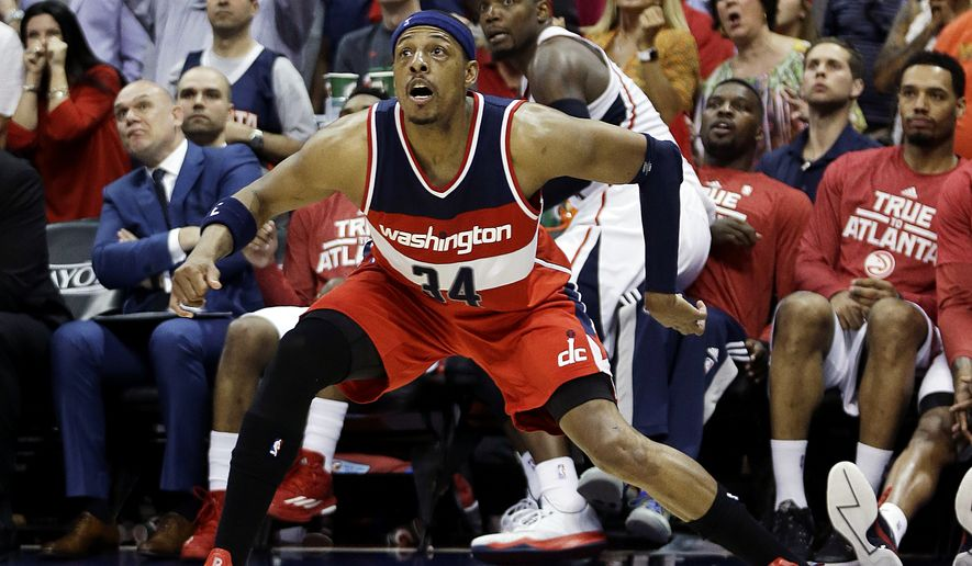 Washington Wizards' Paul Pierce, front, watches as his three-point shot goes in as the Wizards take the lead in the final seconds of Game 5 of the second round of the NBA basketball playoffs against the Atlanta Hawks Wednesday, May 13, 2015, in Atlanta. On the next play the Hawks' Al Horford snatched away an offensive rebound and dropped in the winning basket with 1.9 seconds left giving the Hawks an 82-81 victory and a 3-2 lead in the Eastern Conference semifinals. (AP Photo/John Bazemore)