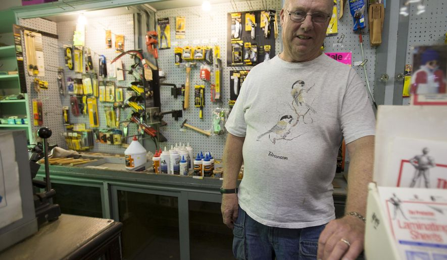 In a Wednesday, May 6, 2015 photo, John Marien, owner, at Marien Pro Hardware, poses in the store on Indy's south side, which is closing its doors after 85 years. It's the latest casualty in the battle for survival among independent hardware stores, who are trying to fight it out, sale by sale, one plumbing fixture or 30-cent bolt at a time, against national chains and big-box stores.(Robert Scheer /The Indianapolis Star via AP)  NO SALES