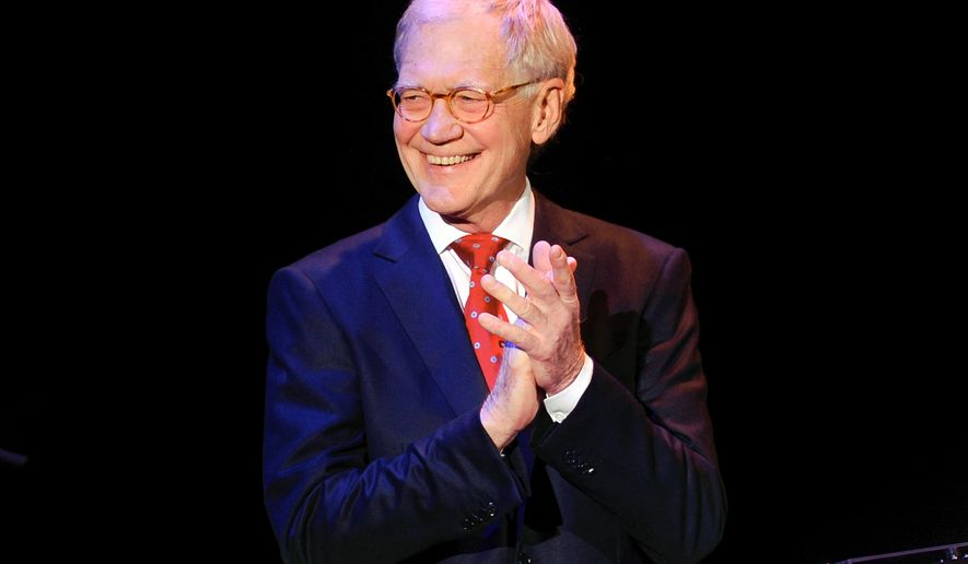 """FILE - In this March 2, 2015 file photo, David Letterman attends """"An Evening of SeriousFun Celebrating the Legacy of Paul Newman"""", hosted by the SeriousFun Children's Network at Avery Fisher Hall in New York. After 33 years hosting late night talk shows, Letterman will retire on May 20. (Photo by Evan Agostini/Invision/AP, File)"""