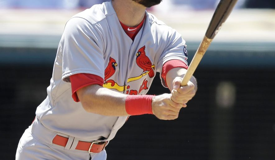 St. Louis Cardinals' Matt Carpenter watches his two-run home run off Cleveland Indians relief pitcher Marc Rzepczynski in the eighth inning of a baseball game, Thursday, May 14, 2015, in Cleveland. Peter Bourjos scored on the play. (AP Photo/Tony Dejak)