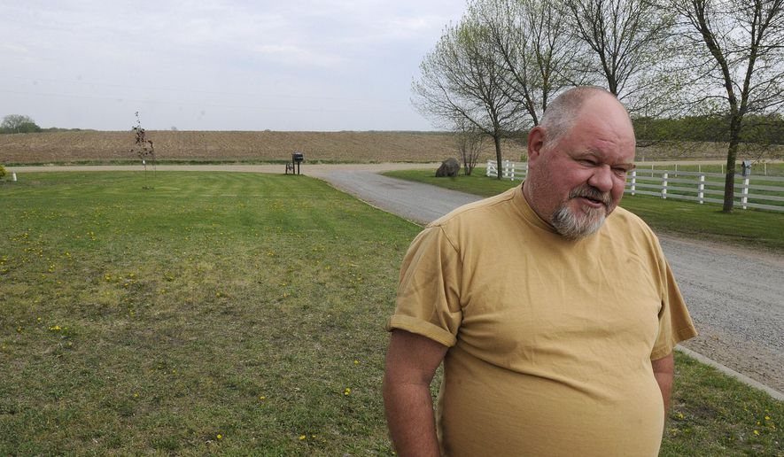 ADVANCED FOR RELEASE MONDAY, MAY 18, 2015 Bradley Lindberg reflects Wednesday, May 6, 2015, on the relocation process he and his wife Linda had to go through when the CapX2020 project ran through their original farm near Clearwater, Minn. (Dave Schwarz/The St. Cloud Times via AP)