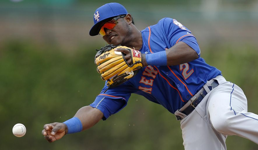 New York Mets second baseman Dilson Herrera (2) throws to first base for an out against Chicago Cubs' Addison Russell (22) during the seventh inning of a baseball game Thursday, May 14, 2015, in Chicago. (AP Photo/Andrew A. Nelles)