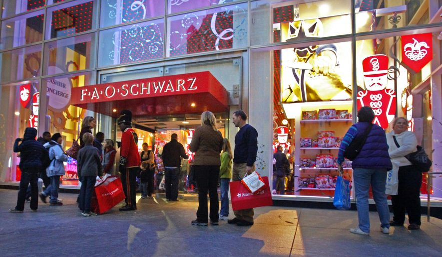 FILE - In this Nov. 21, 2011, file photo, shoppers stand outside of FAO Schwarz in New York. Toys R Us is closing its iconic FAO Schwarz store, citing the high and rising costs of running the retail space on New York City's pricey Fifth Avenue, the company said Friday, May 15, 2015. (AP Photo/Bebeto Matthews, File)
