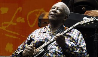 In this June 26, 2010, file photo, B.B. King performs during the Crossroads Guitar Festival in Chicago. King died Thursday, May 14, 2015, peacefully in his sleep at his Las Vegas home at age 89, his lawyer said. (AP Photo/Kiichiro Sato, File)