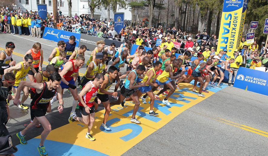 FILE - In this Monday, April 15, 2013 file photo, the elite men start the 117th running of the Boston Marathon in Hopkinton, Mass. (AP Photo/Stew Milne)