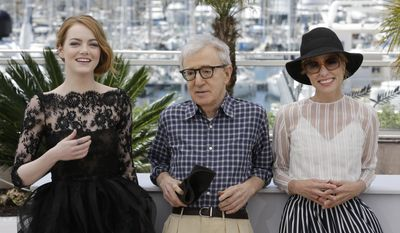 From left, actress Emma Stone, director Woody Allen, and actress Parker Posey pose for photographers during a photo call for the film Irrational Man, at the 68th international film festival, Cannes, southern France, Friday, May 15, 2015. (AP Photo/Lionel Cironneau)