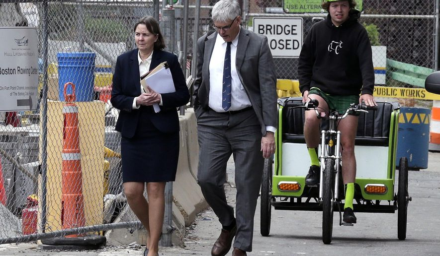 Defense attorneys Judy Clarke, left, and Timothy Watkins walk away from the Moakley Federal Court Friday, May 15, 2015, in Boston, after the U.S. Attorney's office announced that there was a verdict in the penalty phase of the trial of Boston Marathon bomber Dzhokhar Tsarnaev,  Friday, May 15, 2015. The federal jury must decide whether the 21-year-old Tsarnaev should be sentenced to death or life in prison for his role in the deadly attack in 2013. (AP Photo/Charles Krupa)