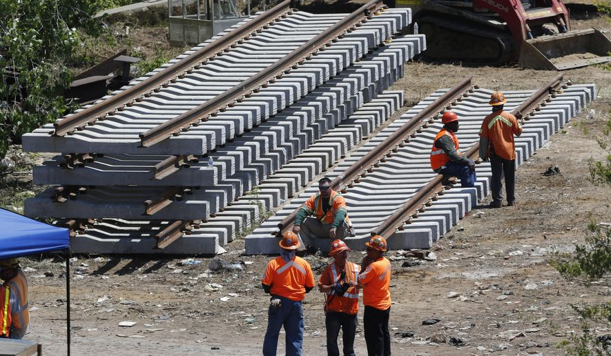 New rail lines are stacked up in an area near the site where a deadly train derailment occurred earlier in the week, Friday, May 15, 2015, in Philadelphia. Amtrak is working to restore Northeast Corridor rail service between New York City and Philadelphia. Service was suspended after a train derailed in Philadelphia on Tuesday night, killing eight passengers and injuring more than 200. (AP Photo/Julio Cortez)