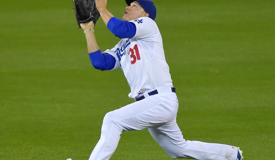 Los Angeles Dodgers center fielder Joc Pederson makes a catch on a ball hit by Colorado Rockies' Troy Tulowitzki during the ninth inning of a baseball game, Thursday, May 14, 2015, in Los Angeles. (AP Photo/Mark J. Terrill)