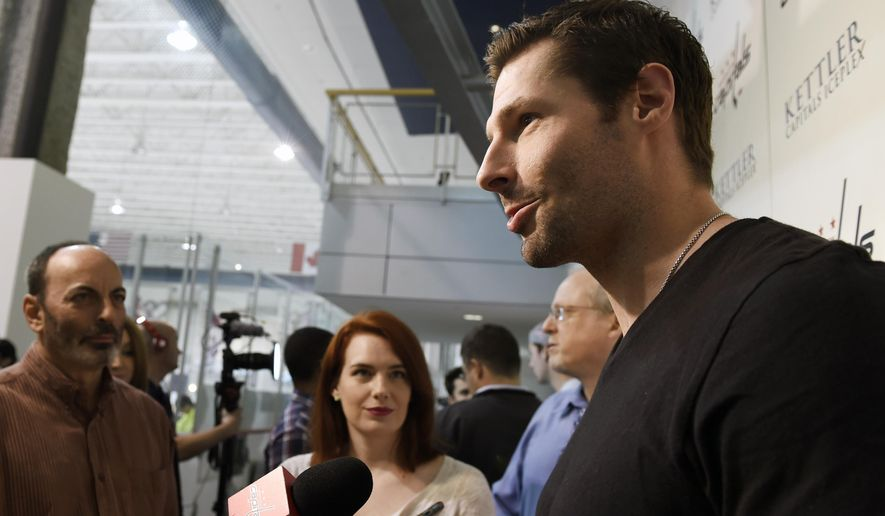 Washington Capitals right wing Troy Brouwer speaks to reporters at the Kettler Capitals Iceplex in Arlington, Va., Friday, May 15, 2015. The Capitals hockey team was eliminated from the Stanley Cup Playoffs and spent the day cleaning out their lockers in preparation for the off season. (AP Photo/Susan Walsh)