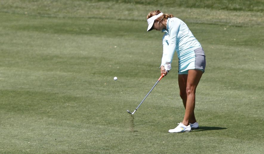 Alison Lee hits the ball on the 15th hole during the second round of the Kingsmill Championship LPGA golf tournament in Williamsburg, Va., Friday, May 15, 2015. (Jonathon Gruenke/The Daily Press via AP)