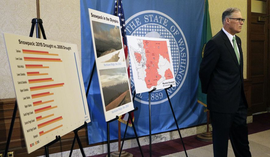 Washington Gov. Jay Inslee stands near placards displaying information on the state's drought situation, Friday, May 15, 2015, in Olympia, Wash. Inslee declared a statewide drought emergency, saying parts of the state have been severely impacted by record low snowpack levels. (AP Photo/Rachel La Corte)