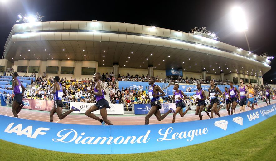 Athletes compete in the men's 3000m steeplechase at the IAAF Diamond League in Doha, Qatar, on Friday, May 15, 2015. (AP Photo/ Osama Faisal )