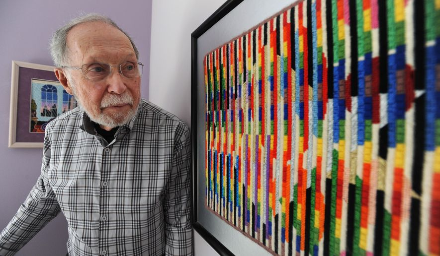 ADVANCE FOR USE MONDAY, MAY 18 - In this photo taken March 11, 2015, Dr. Donald Keta, 86, a retired podiatrist, poses next to a needlepoint based work of artist Yaacov Agam, right, at Keta's home in Bingham Farms, Mich. (Brandy Baker(/Detroit News via AP)  DETROIT FREE PRESS OUT; HUFFINGTON POST OUT, MANDATORY CREDIT