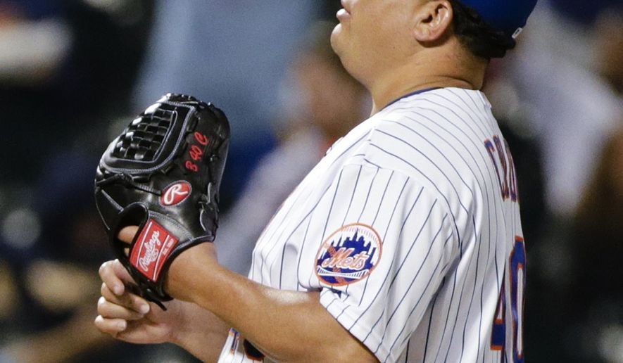 New York Mets starting pitcher Bartolo Colon tosses the ball to himself as Milwaukee Brewers' Gerardo Parra runs the bases after hitting a home run during the fifth inning of a baseball game Friday, May 15, 2015, in New York. (AP Photo/Frank Franklin II)
