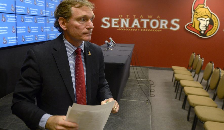 Ottawa Senators team President Cyril Leeder leaves a news conference in Ottawa, Ontario, Thursday, May 14, 2015. Ottawa Senators owner Eugene Melnyk urgently needs a liver transplant, and the team put out a call Thursday for potential donors. (Adrian Wyld/The Canadian Press via AP) MANDATORY CREDIT