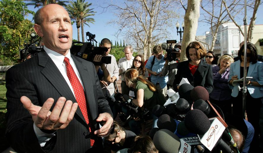 FILE - In this Jan. 16, 2009, file photo, former Orange County Sheriff Mike Carona speaks at a news conference outside court in Santa Ana, Calif. Carona has been freed from a Kentucky prison, where he served 52 months of a 66-month sentence for felony witness tampering. (AP Photo/Nick Ut, File)