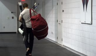 Washington Capitals defenseman Matt Niskanen leave the Kettler Capitals Iceplex in Arlington, Va. Friday, May 15, 2015, after speaking with reporters. The Capitals hockey team was eliminated from the Stanley Cup Playoffs and spent the day cleaning out their lockers in preparation for the off season. (AP Photo/Susan Walsh)