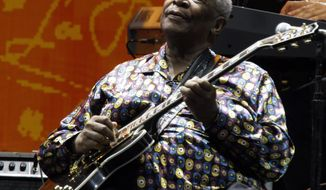 FILE - In this June 26, 2010 file photo, B.B. King performs during the Crossroads Guitar Festival in Chicago.  King died Thursday, May 14, 2015, peacefully in his sleep at his Las Vegas home at age 89, his lawyer said.    (AP Photo/Kiichiro Sato, File)