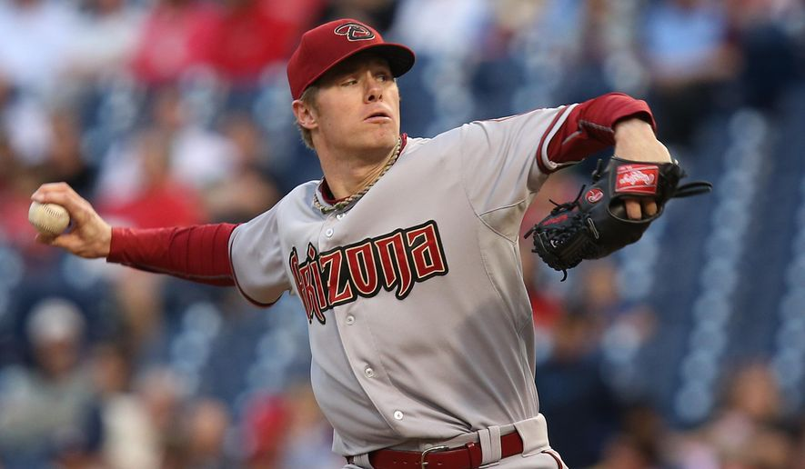 Arizona Diamondbacks starting pitcher Chase Anderson throws during the first inning of a baseball game against the Philadelphia Phillies, Friday, May 15, 2015, in Philadelphia. (AP Photo/Laurence Kesterson)