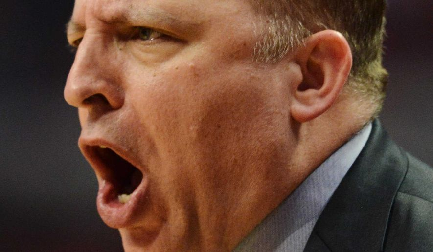 Chicago Bulls coach Tom Thibodeau questions an official's call during Game 6 of the Bulls' NBA basketball second-round playoff series against the Cleveland Cavaliers, Thursday, May 14, 2015, in Chicago. The Cavaliers won 94-73 and advanced to the Eastern Conference finals. (Joe Lewnard/Daily Herald via AP)