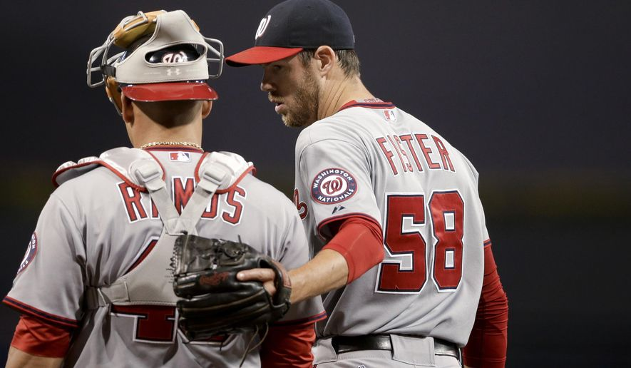 Washington Nationals starting pitcher Doug Fister, right, talks with catcher Wilson Ramos during the first inning in a baseball game against the San Diego Padres on Thursday, May 14, 2015, in San Diego. (AP Photo/Gregory Bull)