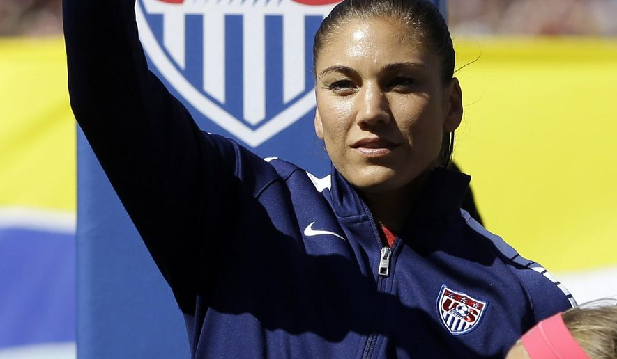 FILE - In this April 4, 2015, file photo, United States goalkeeper Hope Solo waves before the start of an exhibition soccer match against New Zealand in St. Louis, Missouri.  Solo is succinct about her preparedness for the upcoming Women's World Cup. (AP Photo/Jeff Roberson, File)
