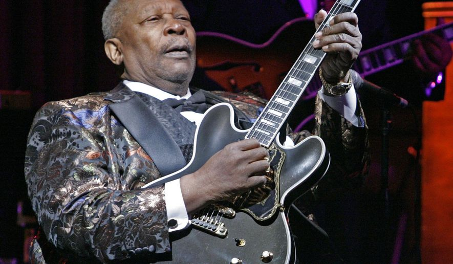 FILE - In this April 18, 2006 file photo,  B.B. King plays during his 10,000th career performance in an appearance at his club in New York.   King died Thursday, May 14, 2015, peacefully in his sleep at his Las Vegas home at age 89, his lawyer said.    (AP Photo/Richard Drew, File)