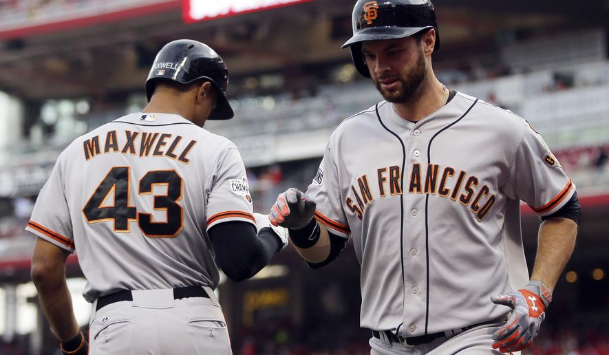 San Francisco Giants' Brandon Belt, right, celebrates with Justin Maxwell after hitting a three-run home run in the first inning of a baseball game against the Cincinnati Reds, Friday, May 15, 2015, in Cincinnati. (AP Photo/John Minchillo)