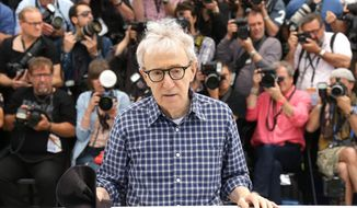 Director Woody Allen poses for photographers during a photo call for the film Irrational Man, at the 68th international film festival, Cannes, southern France, Friday, May 15, 2015. (Photo by Joel Ryan/Invision/AP)