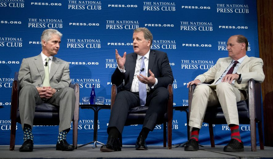 From left, United Airlines Chairman, President and Chief Executive Officer Jeff Smisek, American Airlines Group Chairman and Chief Executive Officer W. Douglas Parker, and Delta Air Lines Chief Executive Officer Richard Anderson, participate in a panel discussion about what they call unfair international competition, Friday, May 15, 2015, at the National Press Club in Washington. (AP Photo/Manuel Balce Ceneta)