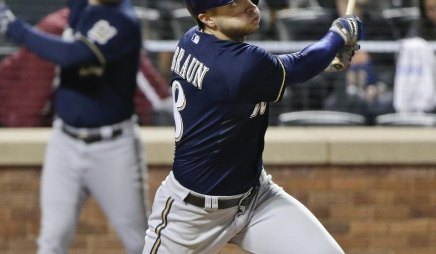 Milwaukee Brewers' Ryan Braun follows through on a home run during the eighth inning of a baseball game against the New York Mets on Friday, May 15, 2015, in New York. (AP Photo/Frank Franklin II)