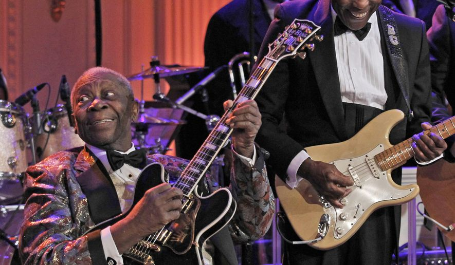 "FILE - In this Feb. 21, 2012, file photo B.B. King, left, and Buddy Guy perform during the White House Music Series saluting Blues Music in the East Room of the White House in Washington. Guy said Friday, May 15, 2015, that he hopes all guitar players remember B.B. King as ""the greatest guitar player that ever lived."" The 89-year-old King died late Thursday at home in Las Vegas. Guy said that he and King had been friends since they met in a Chicago blues club in 1958 and that King ""bent the strings on a guitar like no one else."" (AP Photo/Pablo Martinez Monsivais, File)"