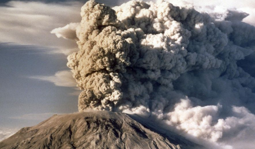 FILE - In this April 1980 file photo, Mount St. Helens spews smoke, soot and ash into the sky in Washington state following a major eruption on May 18, 1980. May 18, 2015 is the 35th anniversary of the eruption that killed more than 50 people and blasted more than 1,300 feet off the mountain's peak. (AP Photo/Jack Smith, file)