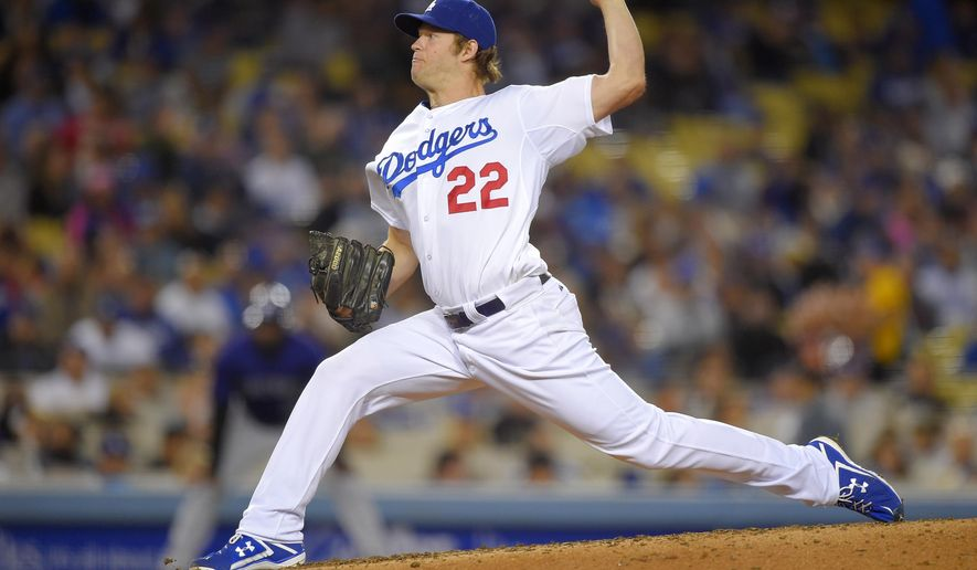 Los Angeles Dodgers starting pitcher Clayton Kershaw throws to the plate during the fourth inning of a baseball game against the Colorado Rockies, Friday, May 15, 2015, in Los Angeles. (AP Photo/Mark J. Terrill)