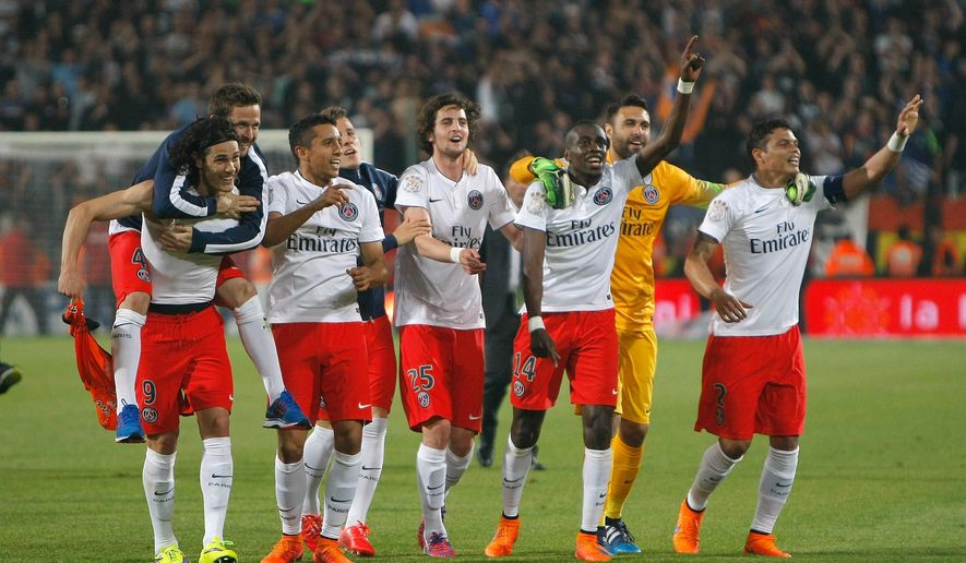 Paris Saint-Germain players, celebrate, after defeating  Montpellier, and winning  the French League One title, at the end of the League One soccer match between Montpellier and Paris Saint-Germain, at the La Mosson Stadium, in Montpellier, southern France, Saturday, May 16, 2015.   (AP Photo/Claude Paris)
