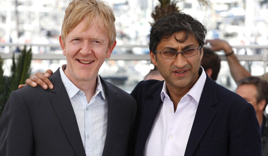 Video editor Chris King and director Asif Kapadia pose for photographers during a photo call for the film Amy, at the 68th international film festival, Cannes, southern France, Saturday, May 16, 2015. (AP Photo/Lionel Cironneau)