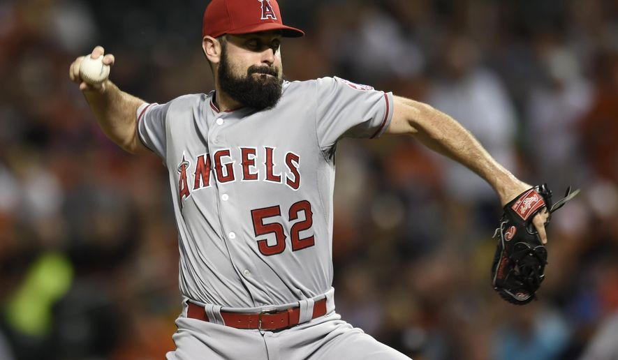 Los Angeles Angels pitcher Matt Shoemaker delivers against the Baltimore Orioles during the first inning of a baseball game Saturday, May 16, 2015, in Baltimore. (AP Photo/Gail Burton)