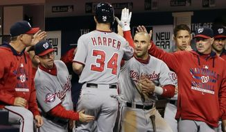 Washington Nationals' Bryce Harper (34) is greeted by teammates after hitting a home run during the fourth inning in a baseball game against the San Diego Padres on Friday, May 15, 2015, in San Diego. (AP Photo/Gregory Bull)