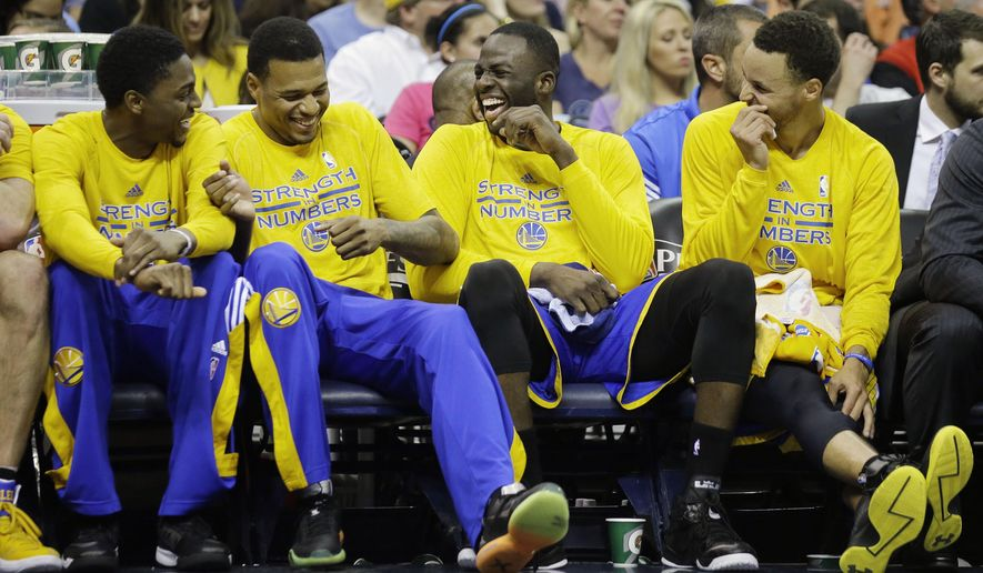 Golden State Warriors players laugh on the bench in the second half of Game 6 of a second-round NBA basketball Western Conference playoff series against the Memphis Grizzlies Friday, May 15, 2015, in Memphis, Tenn. The Warriors won 108-95 to win the series 4-2. From left are Justin Holiday, Brandon Rush, Draymond Green, and Stephen Curry. (AP Photo/Mark Humphrey)