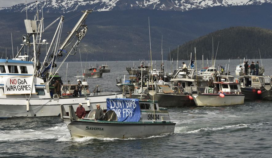 Protesters, demonstrating against the Navy's planned exercises, head out in commercial fishing boats on Orca Inlet, which opens onto the Gulf of Alaska, on Saturday, May 16, 2015, in Cordova, Alaska. They say the military activities could endanger critical fish habitats. (Mark Hoover/Eyak Preservation Council via AP)
